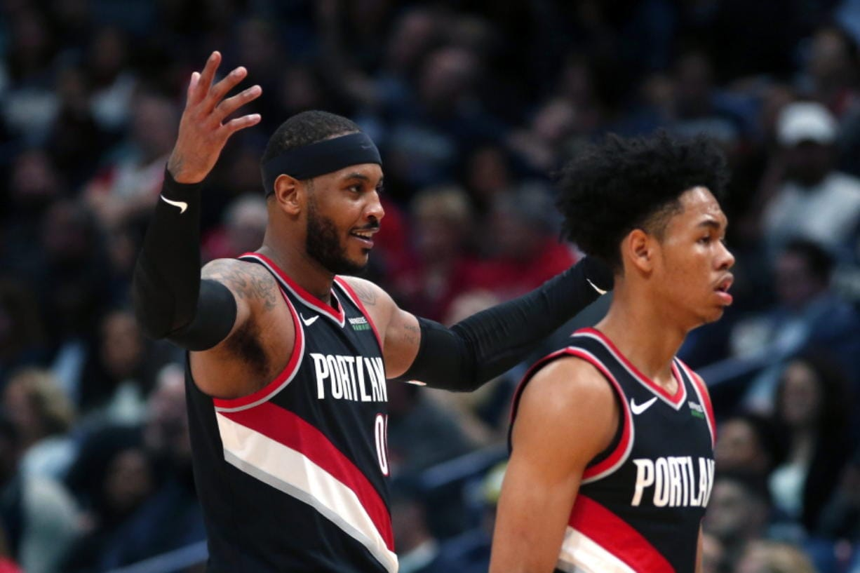 Portland Trail Blazers forward Carmelo Anthony, left, reacts as he walks to the bench with guard Anfernee Simons against the New Orleans Pelicans in New Orleans, Tuesday.