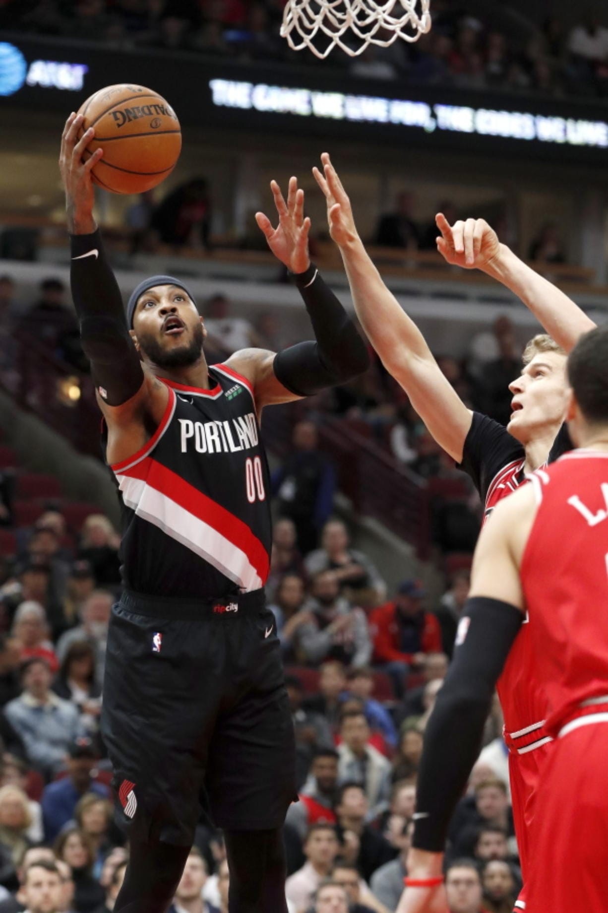 Portland Trail Blazers' Carmelo Anthony scores past Chicago Bulls' Lauri Markkanen during the first half of an NBA basketball game Monday, Nov. 25, 2019, in Chicago. (AP Photo/Charles Rex Arbogast)