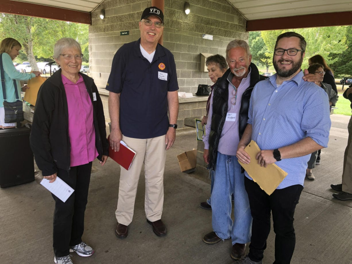 "Jane Shields Lussier, from left, the daughter of former high school football coach Dutch Shields; John Gentry, of the Vancouver Fire Department; Pat Klinger, retired marketer at Burgerville and group founder; and Brad Richardson, executive director of the Clark County Historical Museum, gathered at a picnic in September for the Facebook group ""Growing up in Vancouver, WA."" (Contributed photo)"