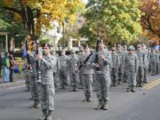 The Prairie High School Armed Drill Team performs at a past veterans parade.