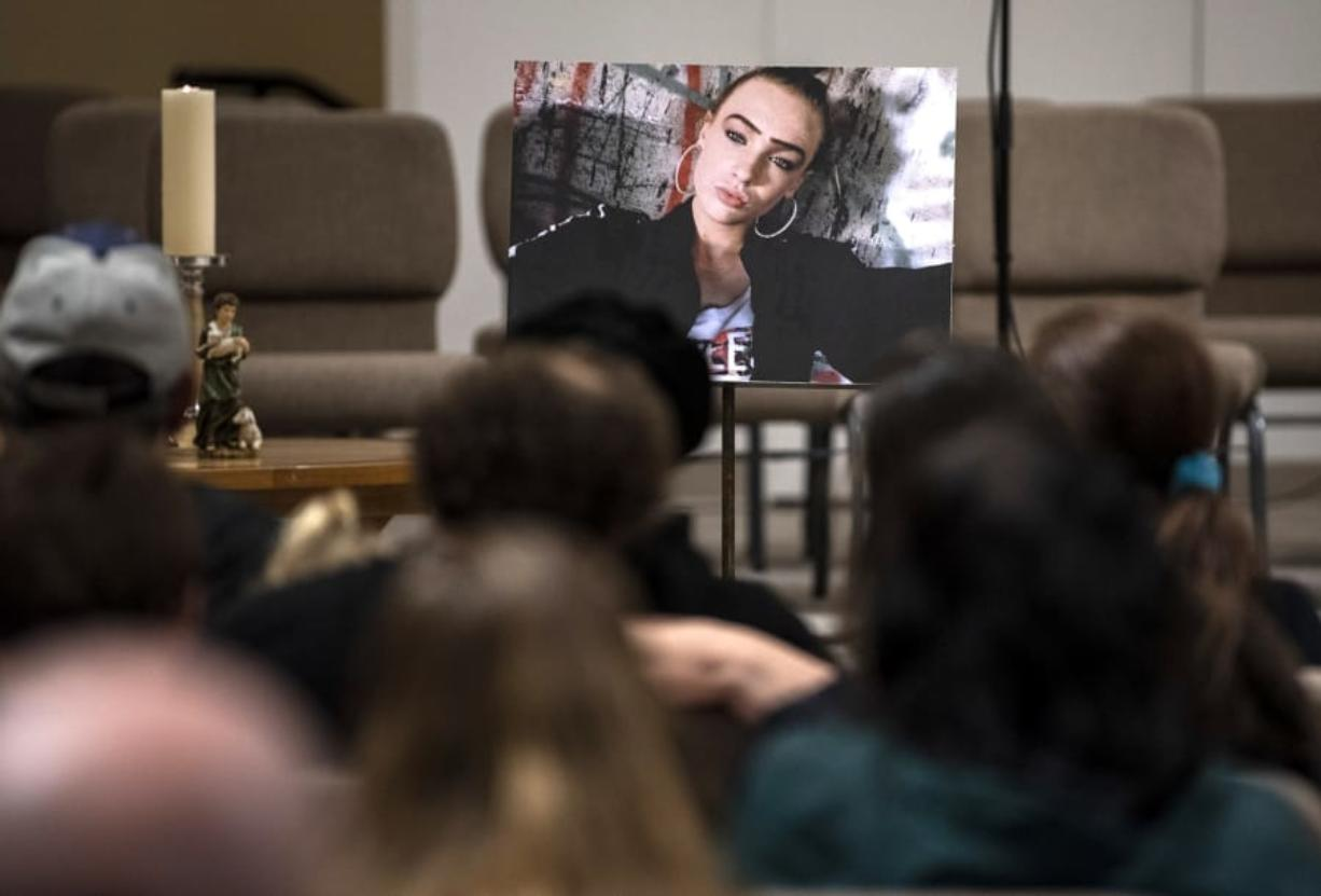 A photo of Nikki Kuhnhausen is placed at the front of the room during the vigil at the Vancouver United Church of Christ in Vancouver on Dec. 20, 2019. (Alisha Jucevic/The Columbian)
