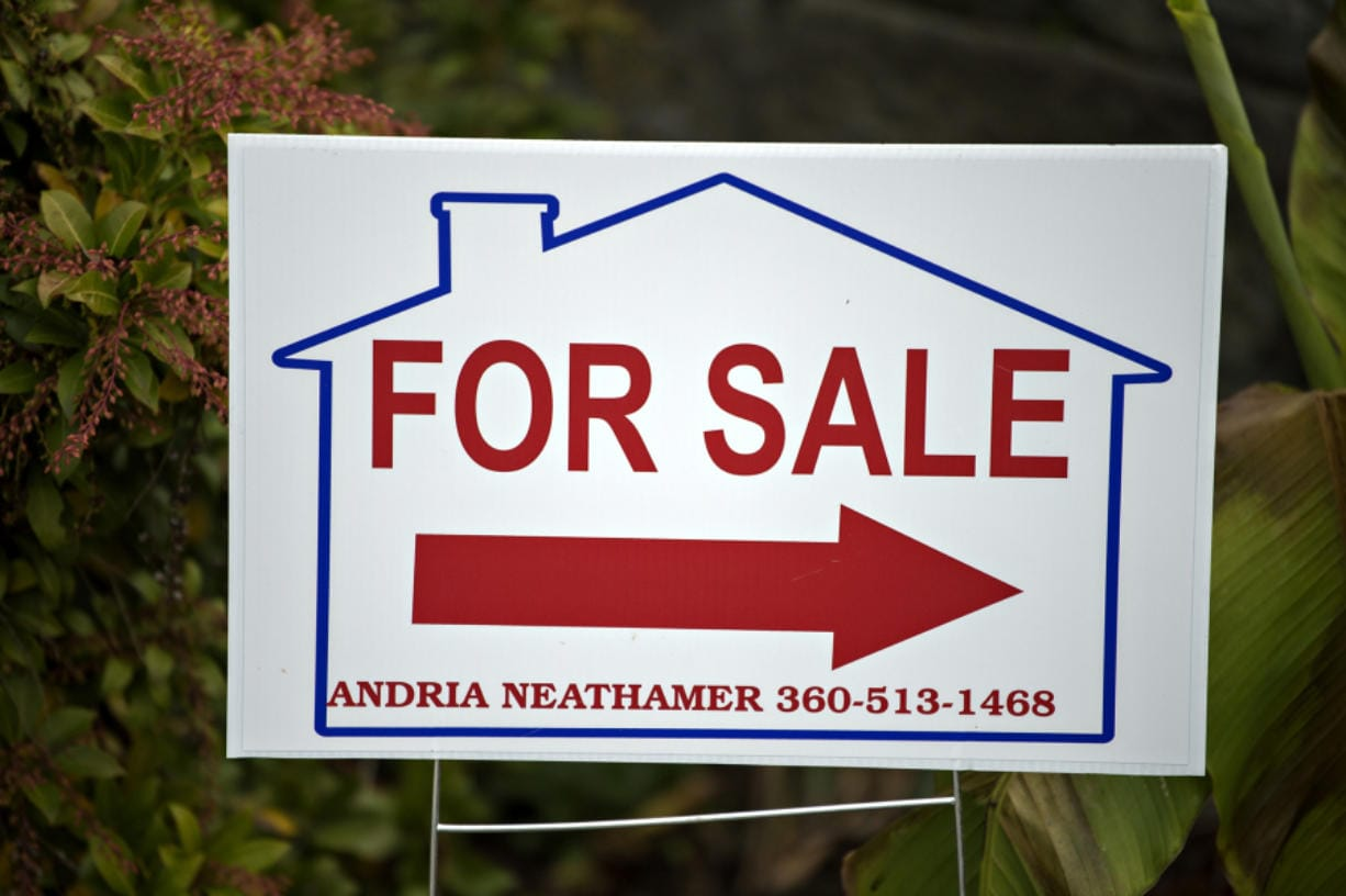 A sign directs home buyers toward a house for sale in Salmon Creek on Oct. 15. Clark County's housing market continued a run of seasonally high sales activity in November, although there was a decline in new listings. (Amanda Cowan/The Columbian)