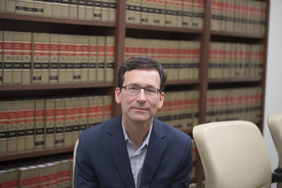 Washington Attorney General Bob Ferguson pauses for a portrait at his office in Seattle.