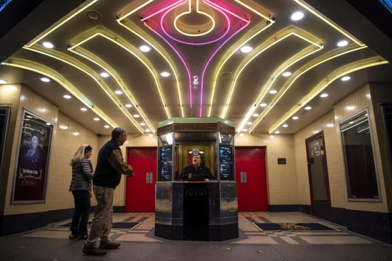 "Richard Beer, programming director at the Kiggins Theatre, staffs the box office for a live performance of ""In Flight with D.B. Cooper,"" an original radio play. (Alisha Jucevic/The Columbian)"