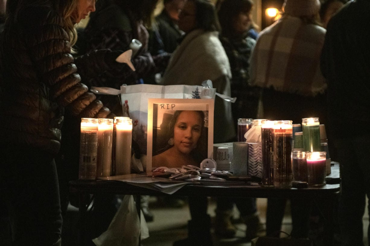 A photo of Tiffany Hill is seen on display at the candlelight vigil at Esther Short Park in Vancouver on Dec. 1.
