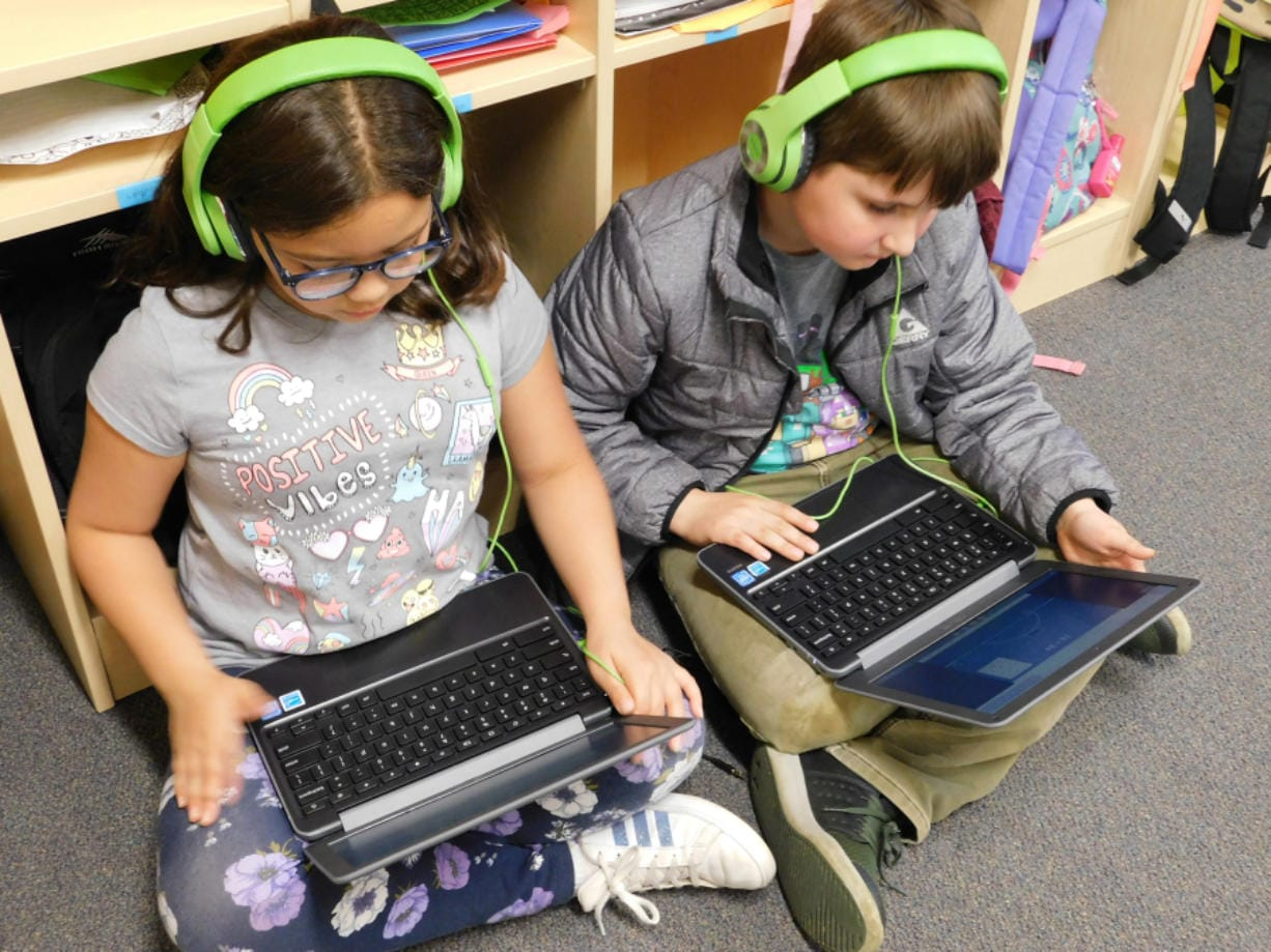 RIDGEFIELD: At South Ridge Elementary School in Ridgefield, students play a math game on laptops during a co-teaching rotation.