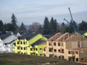 Construction crews work on apartment buildings at the Latitude 45 development, a Ginn Group project near the Four Seasons subdivision in east Vancouver. Ginn Group typically builds single-family detached housing and townhomes; the apartment project represents a new push into multi-family units and rental properties.
