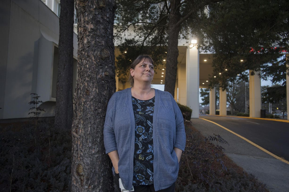 Teresa Kirchner, a leader of a hearing-voices group in Vancouver, stands outside her office on Main Street in Vancouver. The Hearing Voices Network is a guiding organization for more than 180 support groups across the world designed for those who hear voices or have visions that others around them don't see or hear.