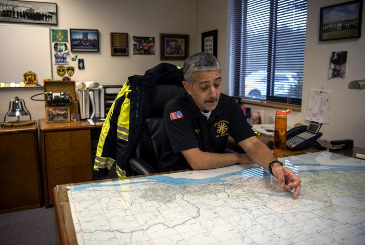 Fire Chief Nick Swinhart describes the Camas-Washougal Fire Department coverage area at his office at Station 42 in Camas. A consulting group recently finished a report saying the department isn't laid out well enough to provide adequate coverage, and suggested relocating two stations and building another.