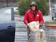 Charlie Atkinson, Walk & Knock food drive site coordinator, helps unload donated food at Chuck's Produce. Atkinson said there was a good response from area residents, who willingly donated a stream of shelf-stable foods.