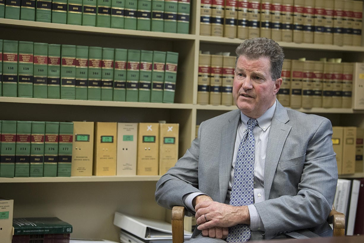 Clark County Superior Court Judge John Fairgrieve talks in his office Friday afternoon about what factors generally go into determining bail and why domestic violence cases are particularly tough to decide. (Amanda Cowan/The Columbian)