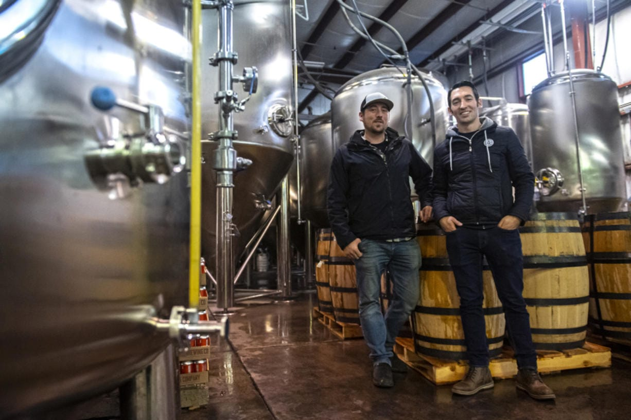 Co-owners of Backwoods Brewing, Tom Waters, left, and Steve Waters stand inside their production facility in Stevenson. The brewery has seen a large amount of growth since it opened in 2012. (Nathan Howard/The Columbian)