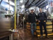 Co-owners of Backwoods Brewing, Tom Waters, left, and Steve Waters stand inside their production facility in Stevenson. The brewery has seen a large amount of growth since it opened in 2012.