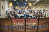 Shoppers check out at the new Ridgefield Rosauers, which opened on Saturday. (Nathan Howard/The Columbian)
