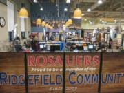 Shoppers check out at the new Ridgefield Rosauers, which opened on Saturday.