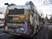 The Battle Ground-themed bus at a stop in downtown Vancouver.