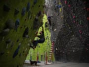 """Nathan Ordanza, of Vancouver, boulders at the Source Climbing Center in Vancouver. Ordanza said he likes climbing because it's a good workout that focuses on problem solving. """"With the rainy season here, you can still workout without having to go outside,"""" he said."""