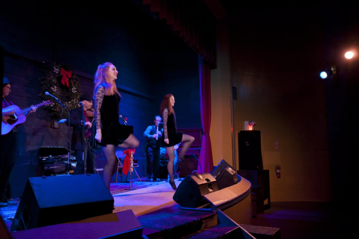 Joined by Portland-based Irish dancers Brittany Ramsey, left, and Marisa Gilman, Molly's Revenge played a number of original and traditional Celtic songs Sunday at the Old Liberty Theater in Ridgefield.