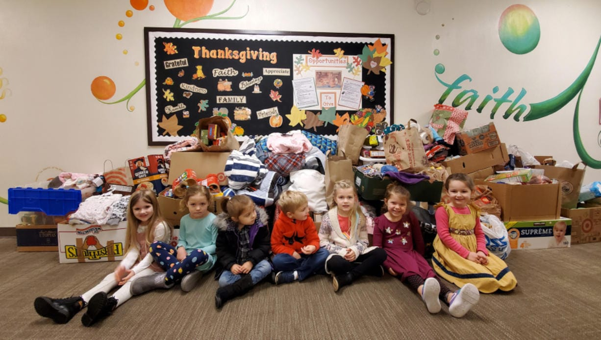 Vancouver Heights: Students at Circle of Friends Preschool with some of the items collected for their needs drive. Each November, the school holds a needs drive to benefit local schools and charities.