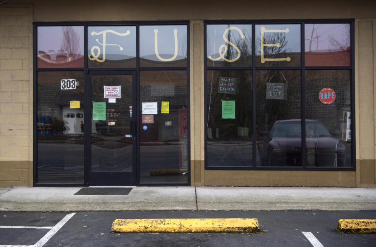 Fuse Vapor in Hazel Dell is one of the first three shops to get hit with a license suspension for not complying with the state's ban on flavored vapor products. Owner Marcus Torres said he intends to close the store.