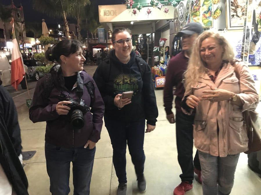 Columbian Photo Editor Amanda Cowan, left, and Assistant Metro Editor Jessica Prokop explore downtown Tijuana, Mexico, in November 2019 with Ramon and Enedis Flores.