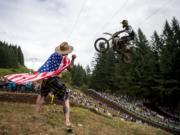 Matt Minor of Salem, Ore., cheers on the riders as they glide over a jump at the top of the course during the Washougal National Lucas Oil Pro Motocross at the Washougal MX Park on Saturday afternoon, July 27, 2019.