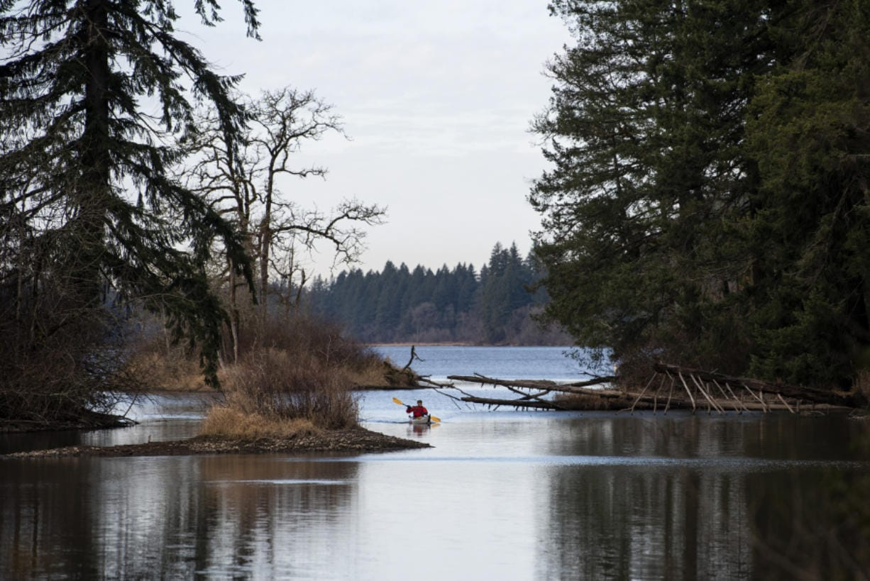 Jerry Ames of Vancouver kayaks on Lacamas Lake in Camas on Thursday. Ames said he wanted to take advantage of the nice weather to get out on the lake before the rain rolls in. The forecast calls for cloudy weather and possible showers over the weekend. (Photos by Alisha Jucevic/The Columbian)