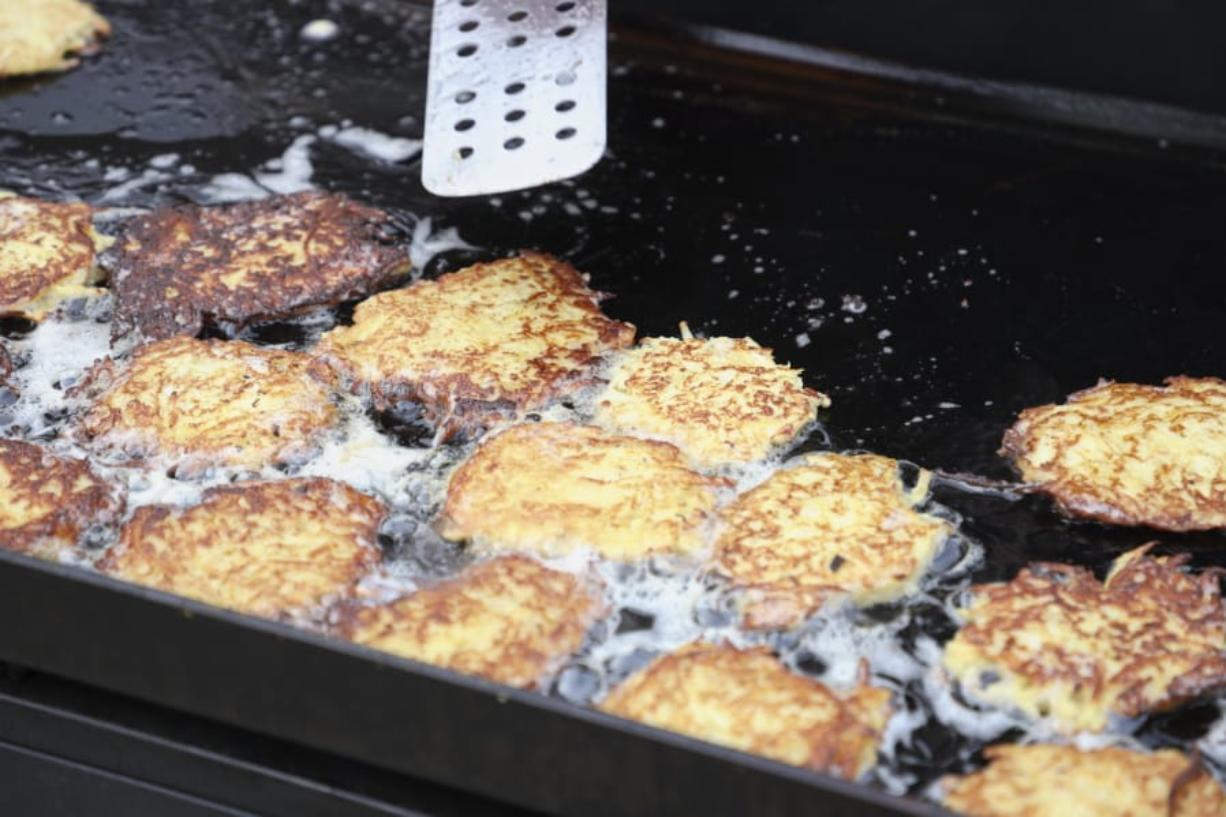 Potato latkes cook on a grill at Congregation Kol Ami. The congregation's men's club cooked the potato pancakes for the annual Latke Fest, a potluck held during Hanukkah.