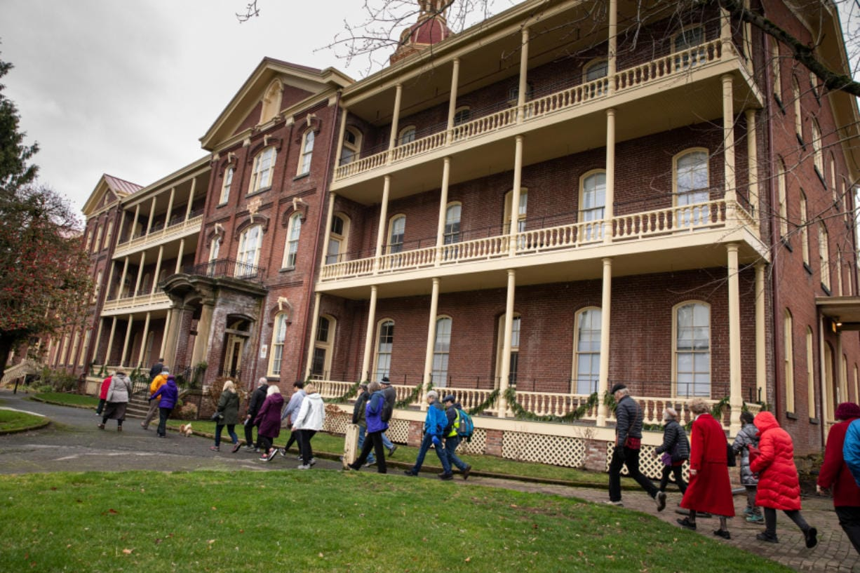 Several dozen people arrive at Providence Academy, completing a 1.6 mile-walk from the Vancouver waterfront on Sunday. The event was hosted by The Historic Trust and retraced the steps of the Sisters of Providence arrival in Vancouver in 1856.