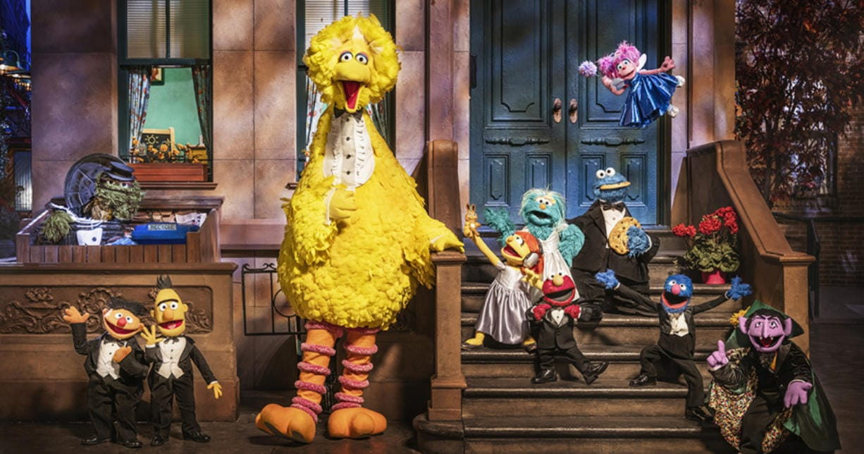 """""""Sesame Street"""" characters, from left, Oscar the Grouch, Ernie, Bert, Big Bird, Julia, Rosita, Elmo, Cookie Monster, Abby Cadabby, Grover and the Count."""