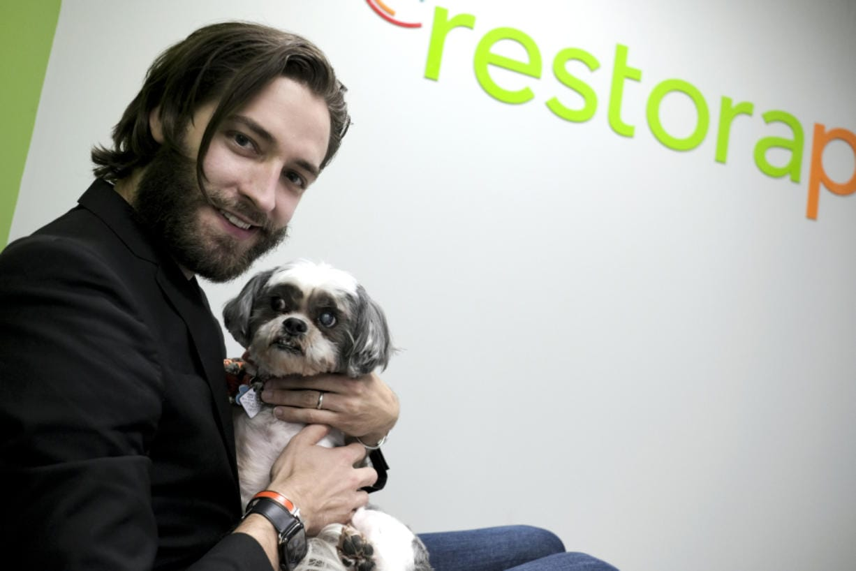 Brian Larsen, holding his buddy Nibber, is the founder and CEO of RestoraPet in Gaithersburg, Md., which makes nutritional supplements for dogs, cats and horses.