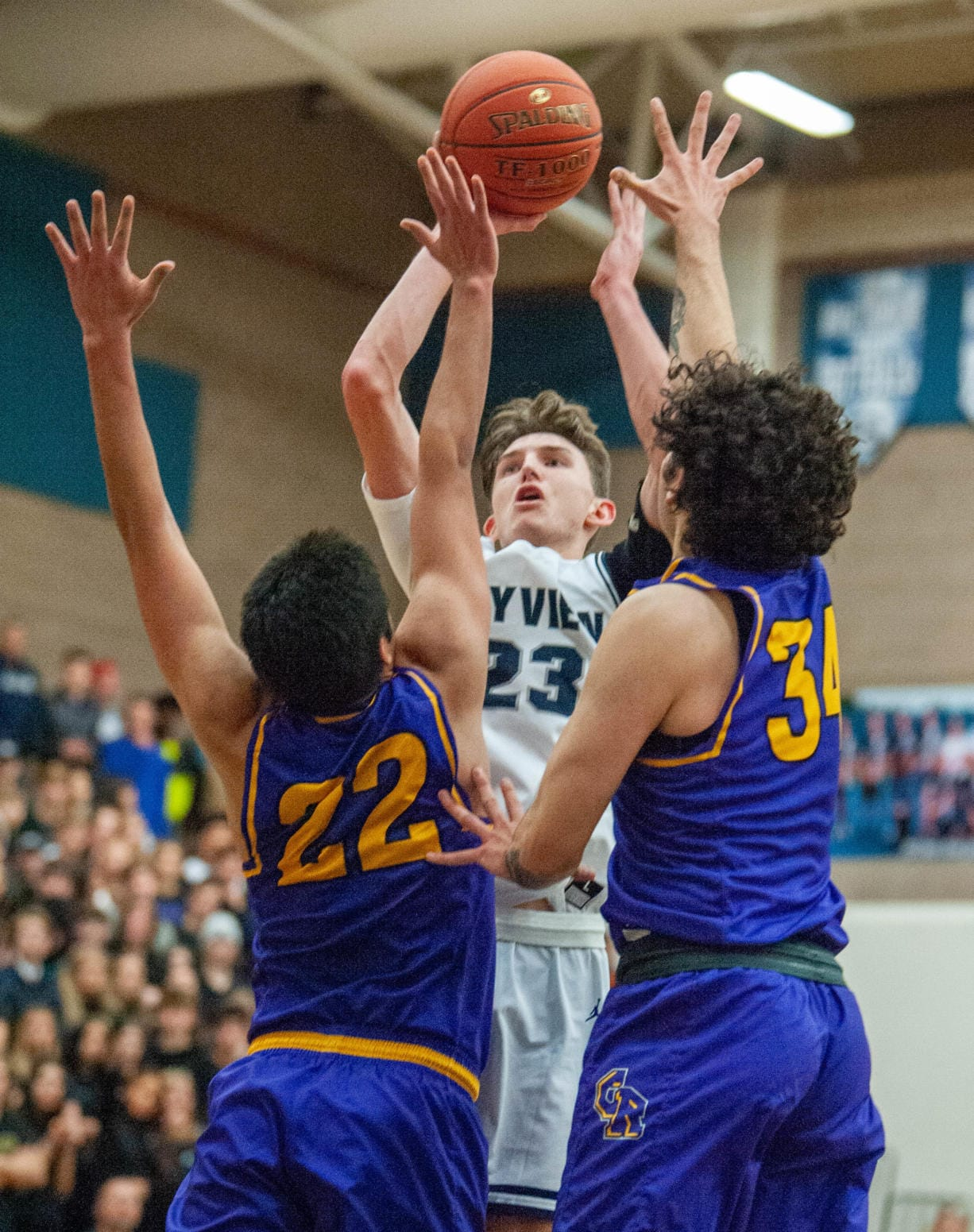 Skyview's Kyle Gruhler makes a game-clinching floater late in the fourth quarter over Columbia River's Marc Miranda (22) and Dylan Valdez (34).