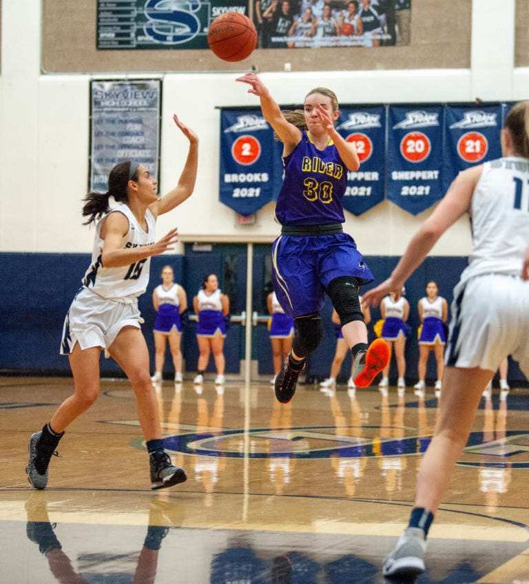 Columbia River's Jordan Ryan makes  a pass for an assist. (Joshua Hart/The Columbian)