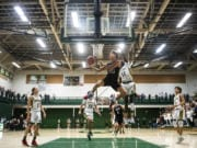 Union's Josh Reznick competes a layup against Evergreen during a game at Evergreen High School on Wednesday night.