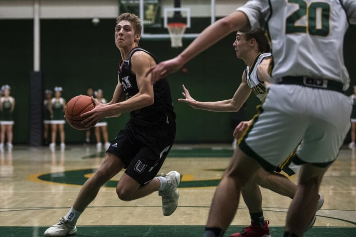 Union's Tanner Toolson drives against Evergreen on Wednesday night.