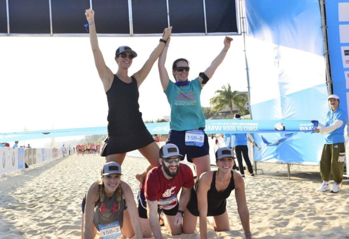 The team of Clark County runners, clockwise from top left, Ericka Carlsen, Marlene Ashworth, Alexis Bond, David Belokonny and Katy Belokonny pose at the finish line after completing Hood to Coast Hainan in China.