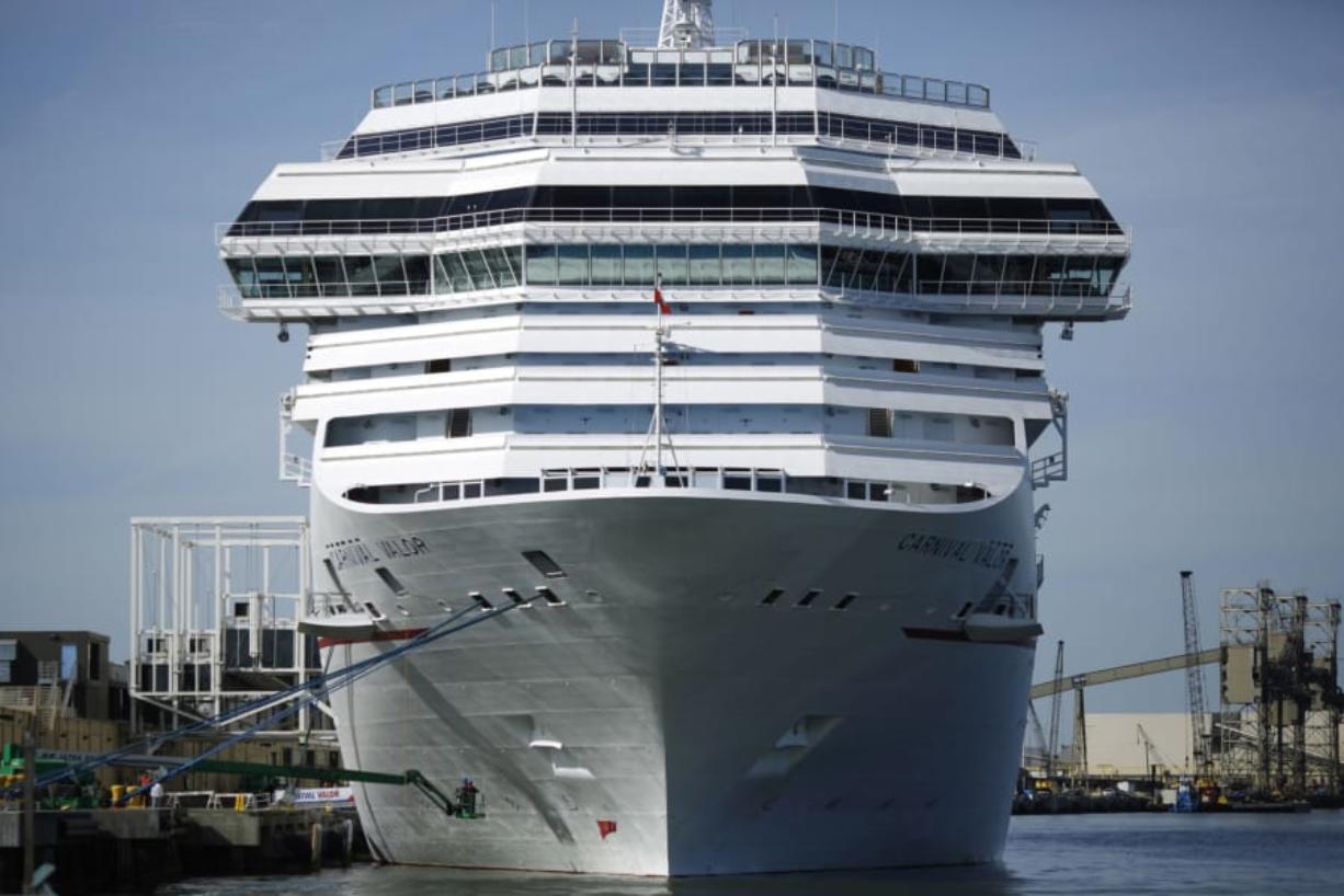 The Carnival Corp. cruise ship Carnival Valor is docked at the Port of Galveston in Galveston, Texas, in 2017. (Luke Sharrett/Bloomberg)