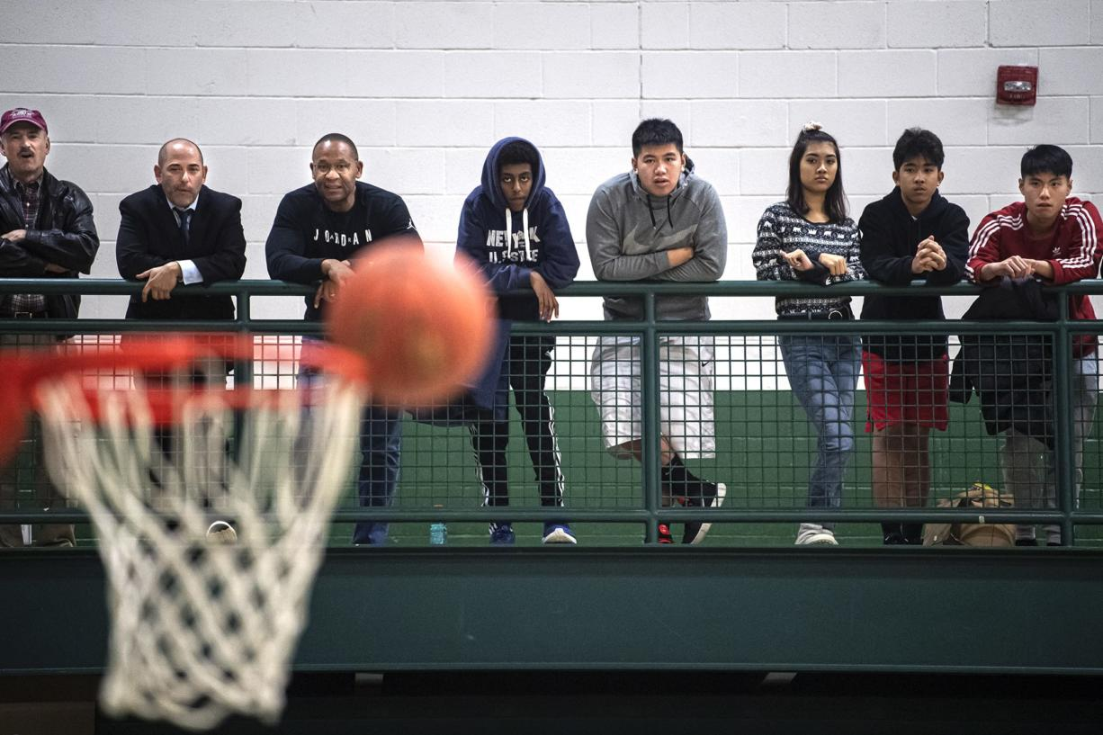 Spectators watch as a ball bounces off Union's hoop during a game between Evergreen and Union at Evergreen High School on Wednesday night, Dec. 17, 2019.