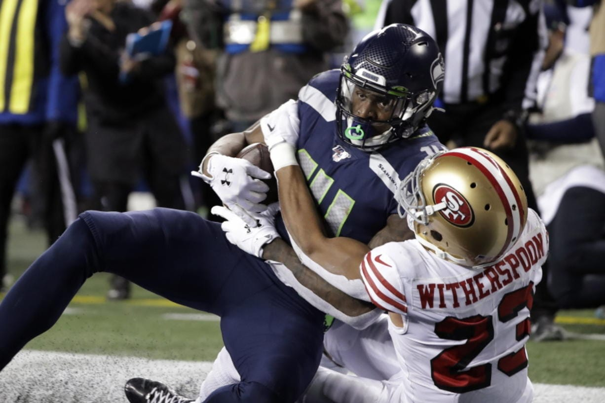 Seattle Seahawks' Marshawn Lynch (24) scores a touchdown on a 1-yard rush against the San Francisco 49ers during the second half of an NFL football game, Sunday, Dec. 29, 2019, in Seattle.