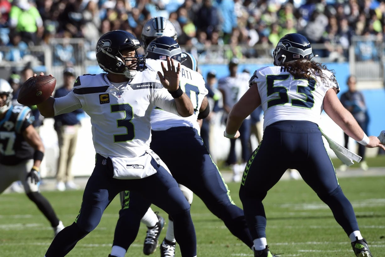 Seattle Seahawks quarterback Russell Wilson (3) passes against the Carolina Panthers during the first half of an NFL football game in Charlotte, N.C., Sunday, Dec. 15, 2019. (AP Photo/Mike McCarn)