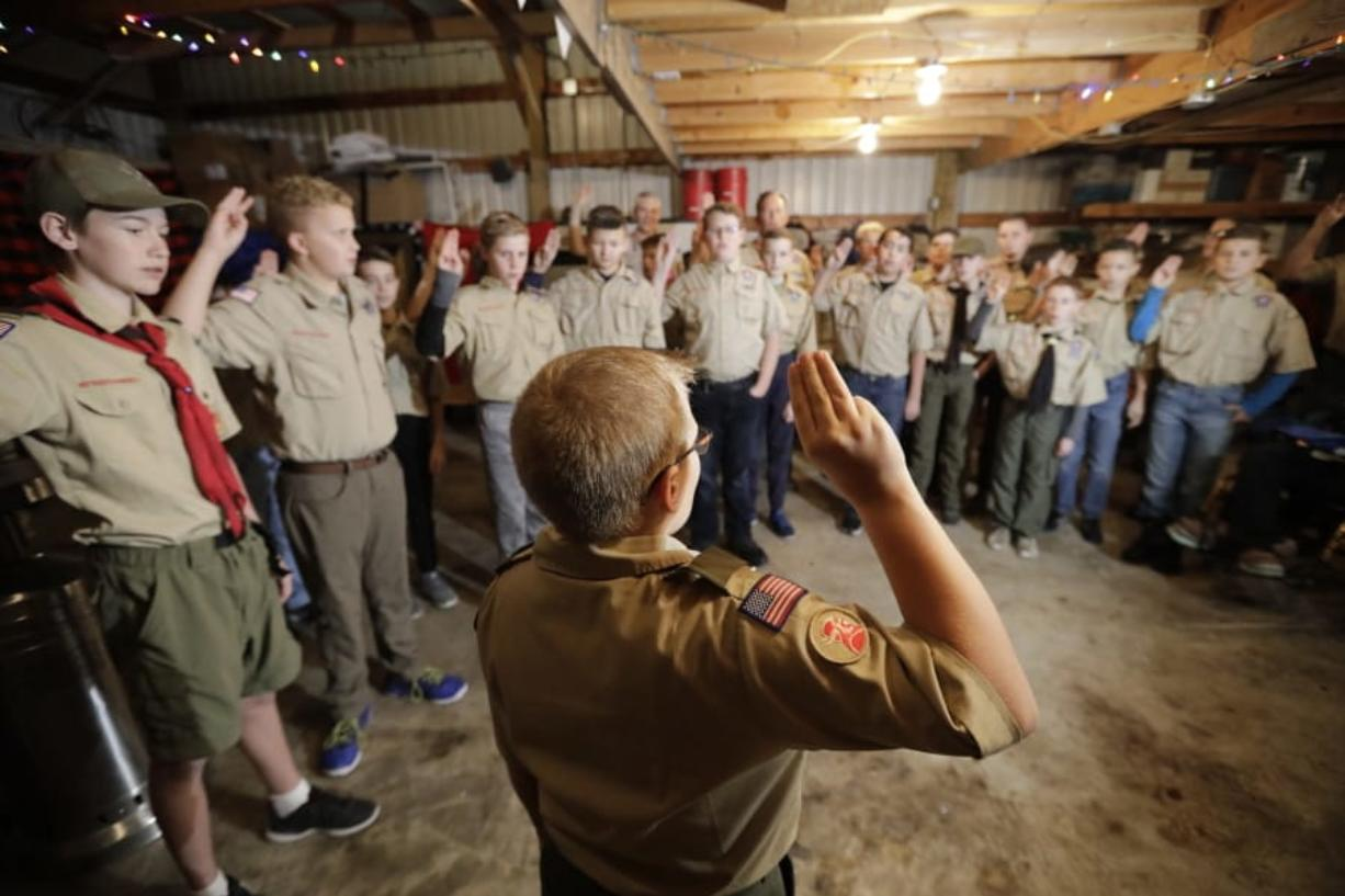 In this Thursday, Dec. 12, 2019 photo, a Boy Scouts troop gathers during their meeting, in Kaysville, Utah. For decades, The Church of Jesus Christ of Latter-day Saints was one of Boy Scouts of America's greatest allies and the largest sponsor of troops. But on Jan. 1, the Utah-based faith will deliver the latest body blow to the struggling BSA when it implements its plan to pull out more than 400,000 youths and move them into a new global program of its own.