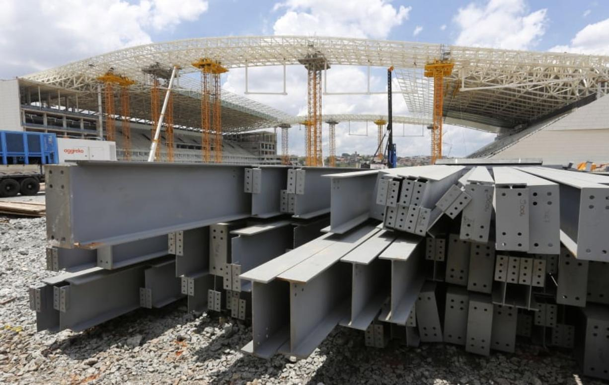 In this Dec. 8, 2013 file photo, steel beams sit outside Arena de Sao Paulo in Sao Paulo, Brazil. President Donald Trump on Monday accused Brazil and Argentina of hurting American farmers through currency manipulation and said he'll slap tariffs on their steel and aluminum imports to retaliate. (AP Photo/Ferdinand Ostrop, File)