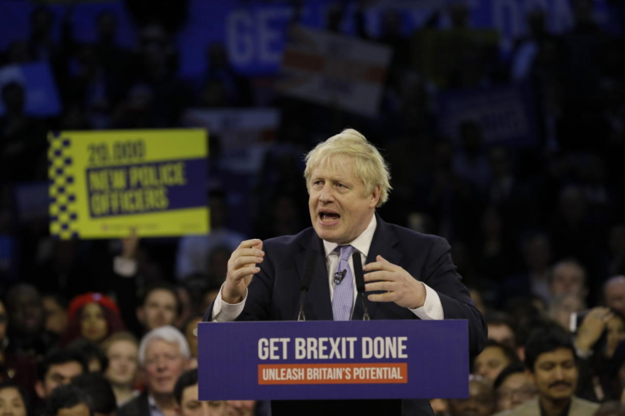 Britain's Prime Minister Boris Johnson speaks during his ruling Conservative Party's final election campaign rally at the Copper Box Arena in London, Wednesday, Dec. 11, 2019. Britain goes to the polls on Dec. 12.