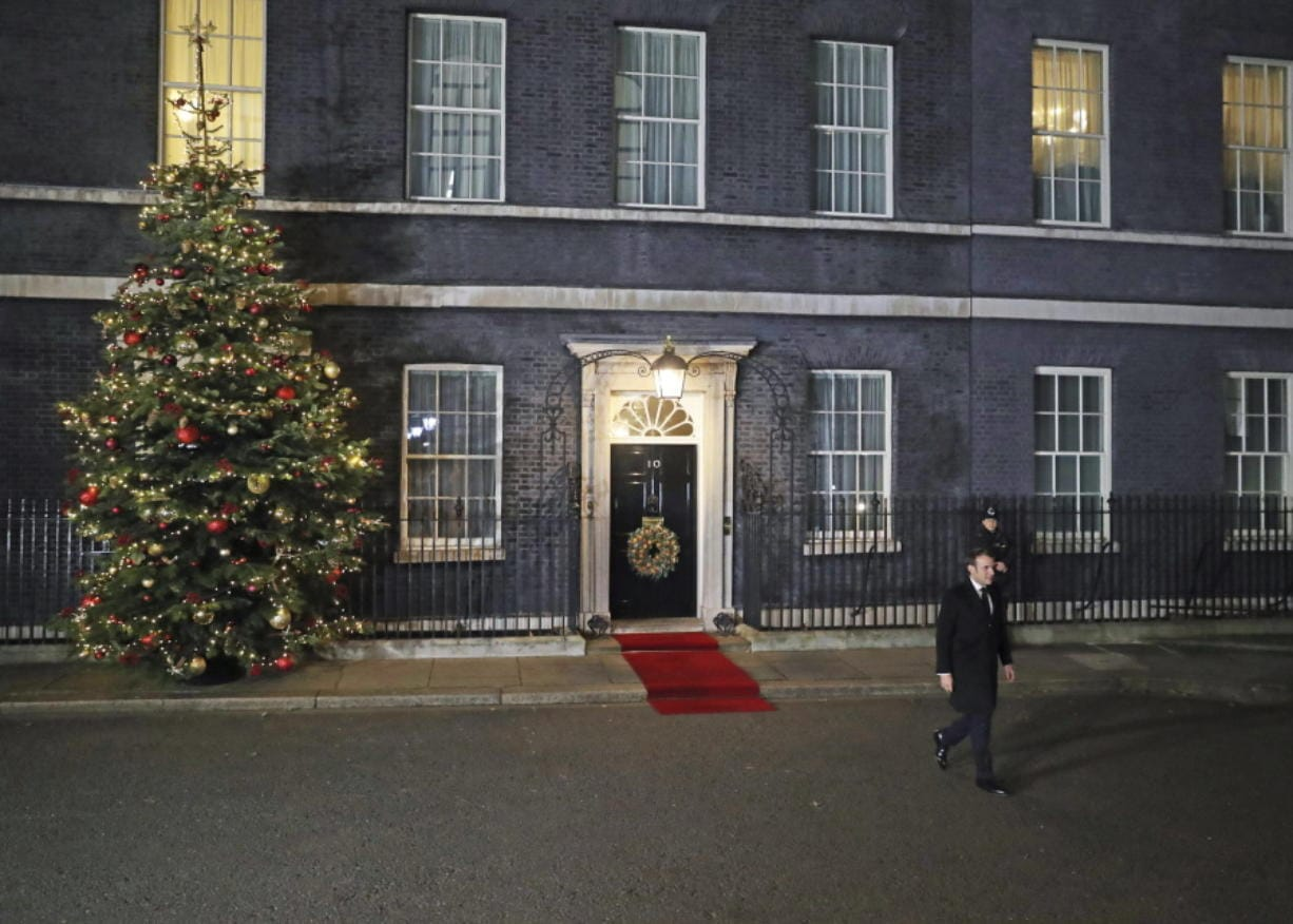 French President Emmanuel Macron leaves 10 Downing Street after meeting with Britain's Prime Minister Boris Johnson and other heads of State, ahead of the NATO summit, in London, Tuesday, Dec. 3, 2019.  U.S. President Donald Trump and his NATO counterparts were gathering in London Tuesday to mark the alliance's 70th birthday amid deep tensions as spats between leaders expose a lack of unity that risks undermining military organization's credibility. (Daniel Leal-Olivas/Pool Photo via AP)