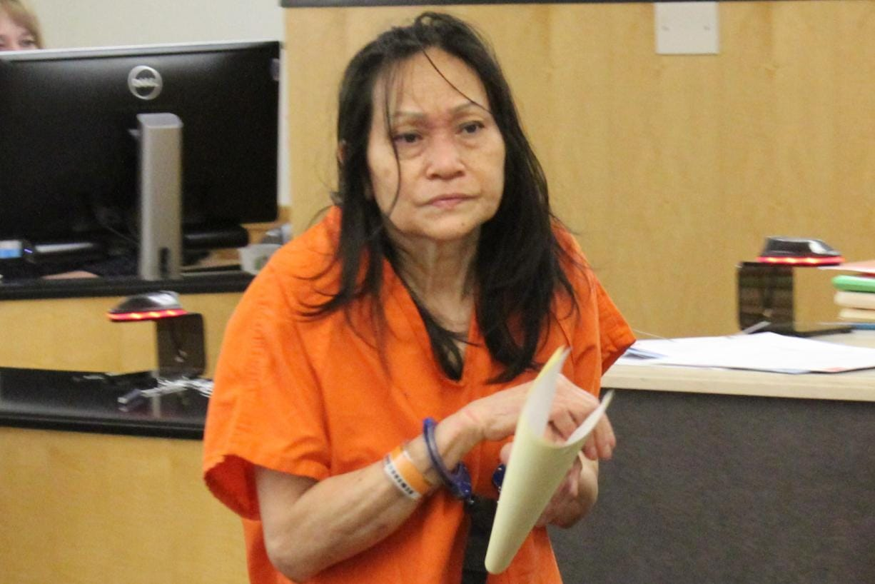 Momlami Dara, 59, appears in Clark County Superior Court on Friday to face a charge of second-degree attempted murder for allegedly stabbing her husband, who wanted a divorce. (Jerzy Shedlock/The Columbian)