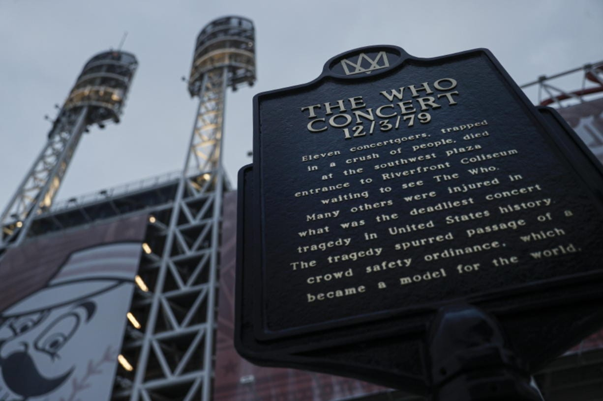 A memorial plaque for eleven concertgoers killed at a 1979 concert stands between Great American Ballpark and Heritage Bank Arena,  in Cincinnati. Tragedy four decades ago linked the British rock band The Who to a small suburban city in Ohio. (John Minchillo/Associated Press)