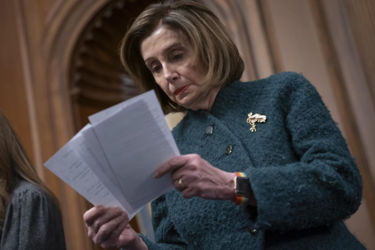 Speaker of the House Nancy Pelosi, D-Calif., reads a note handed to her from an aide as she attends a health care event at the Capitol in Washington, Wednesday, Dec. 11, 2019.  (AP Photo/J.