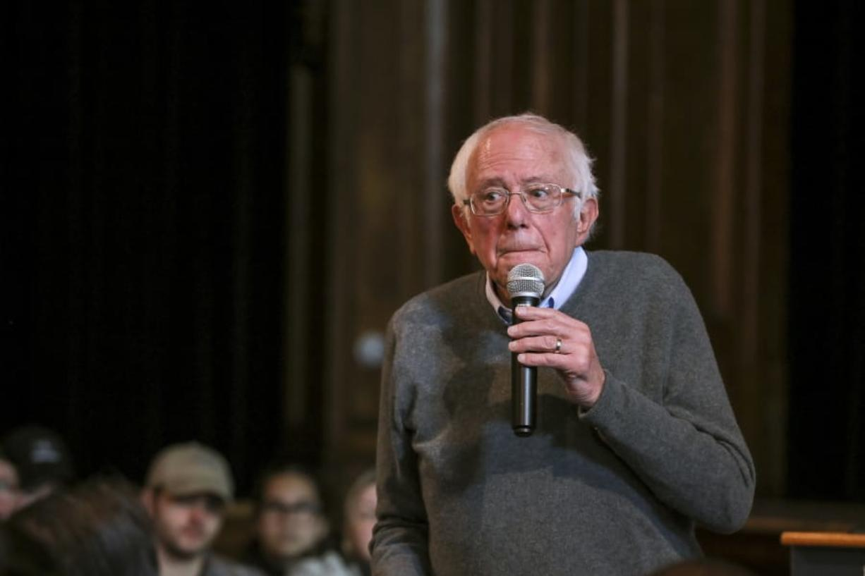Democratic presidential candidate Sen. Bernie Sanders, I-Vt., listens as an audience member poses a question at a Newport Town Hall Breakfast Sunday, Dec. 29, 2019, at the Newport Opera House in Newport, N.H. (AP Photo/Cheryl Senter)