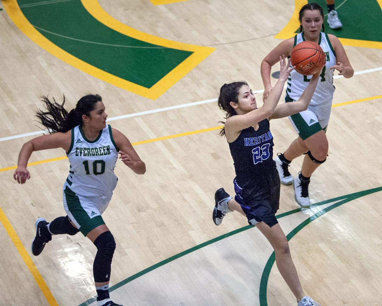 Images from Heritage's 57-19 win over Evergreen in girls basketball nonleague play Tuesday at Evergreen High School.
