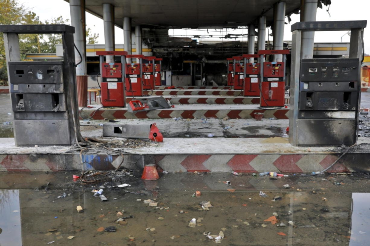FILE - In this Nov. 20, 2019, file photo, rainwater pools at a gas station attacked during protests over government-set gasoline prices in Tehran, Iran. Amnesty International says at least 208 people in Iran have been killed amid protests over sharply rising gasoline prices and a subsequent crackdown by security forces. The country has yet to release any nationwide statistics about the unrest last month.